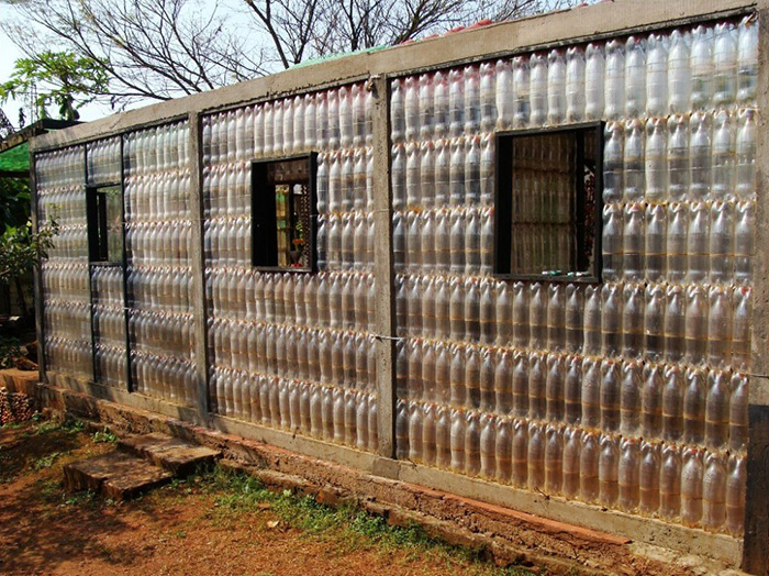 Eco friendly plastic houses - Building a house with plastic bottles ...